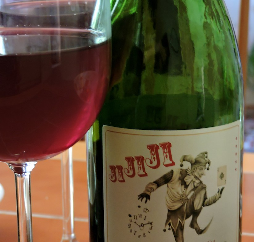 Jijiji Pinot–Malbec. It's pale with hints of something darker and looks almost cloudy. Whatever it is, it's good.
